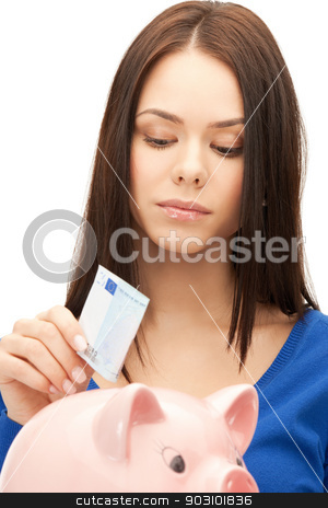 lovely woman with piggy bank and money stock photo, picture of lovely woman with piggy bank and money by Syda Productions