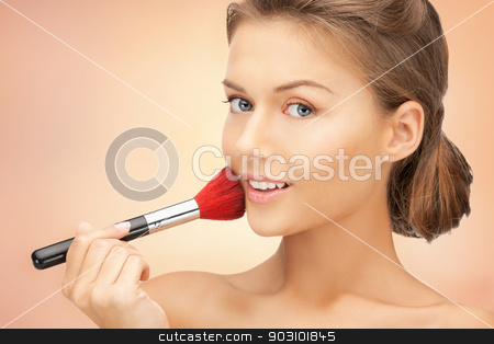 beautiful woman with brush stock photo, bright closeup portrait picture of beautiful woman with brush by Syda Productions