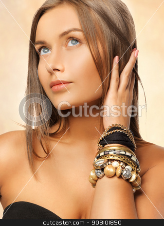 beautiful woman with bracelets stock photo, bright picture of beautiful woman with bracelets by Syda Productions