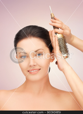 beautiful woman with comb stock photo, bright picture of beautiful woman with comb by Syda Productions