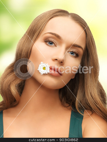 woman with camomile in mouth stock photo, picture of beautiful woman with camomile in mouth by Syda Productions