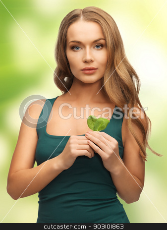 woman with spinach leaves stock photo, bright picture of woman with spinach leaves by Syda Productions
