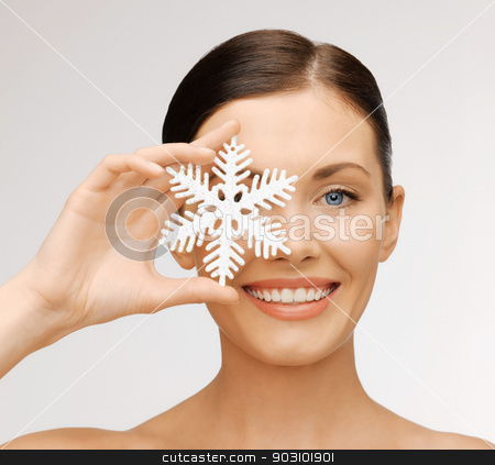 woman with snowflake stock photo, bright picture of beautiful woman with snowflake by Syda Productions