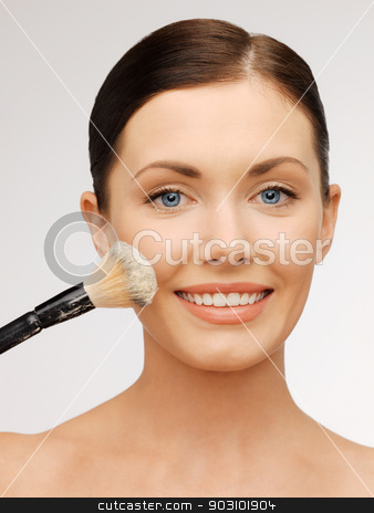 beautiful woman with brush stock photo, bright closeup portrait picture of beautiful woman with brush. by Syda Productions