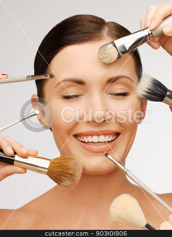 beautiful woman with brushes stock photo, bright closeup portrait picture of beautiful woman with brushes. by Syda Productions