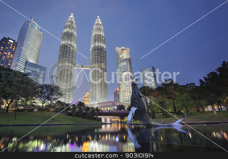 Kuala Lumpur KLCC Park Skyline stock photo, KUALA LUMPUR, MALAYSIA - FEBRUARY 7, 2014 - Kuala Lumpur KLCC Park Skyline with Twin Towers Petronas at Blue Hour. Petronas Twin Tower was the tallest buildings in the world from 1998 to 2004 until it was surpassed by Taipei 101. It remains the tallest twin towers in the world. by Jit Lim