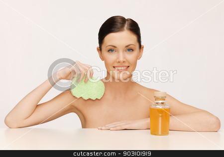 woman with sponge stock photo, picture of woman with sponge and cosmetic bottles by Syda Productions