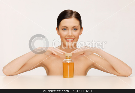 woman with oil bottle stock photo, picture of beautiful woman with oil bottle by Syda Productions
