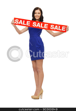 lovely woman in blue dress with sale sign stock photo, picture of lovely woman in blue dress with sale sign by Syda Productions