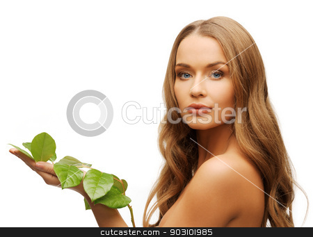 woman with green leaf stock photo, picture of woman with green leaf over white. by Syda Productions