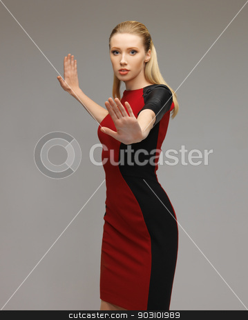 woman working with something imaginary stock photo, picture of futuristic woman working with something imaginary by Syda Productions