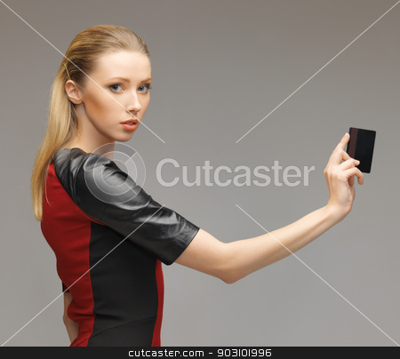 woman with access card stock photo, picture of futuristic woman with access card. by Syda Productions