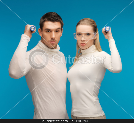 man and woman with pocket flashlights stock photo, picture of  man and woman with pocket flashlights by Syda Productions