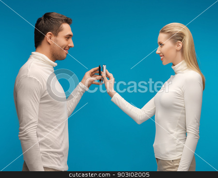 man and woman with modern gadgets stock photo, picture of man and woman with modern gadgets by Syda Productions