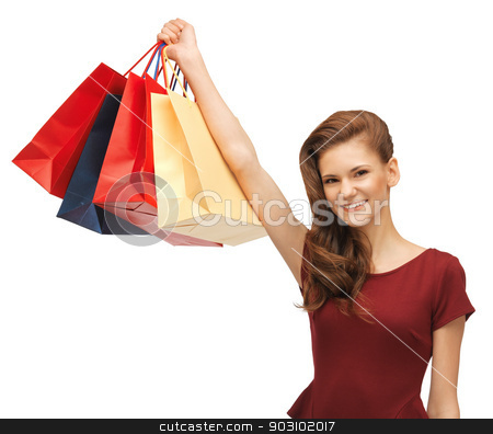 teenage girl in red dress with shopping bags stock photo, picture of teenage girl in red dress with shopping bags by Syda Productions