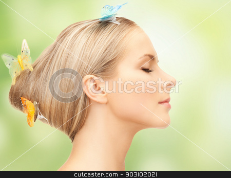 woman with butterfly in hair stock photo, picture of beautiful woman with butterfly in hair by Syda Productions