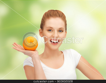 teenage girl with orange stock photo, picture of beautiful teenage girl with orange by Syda Productions