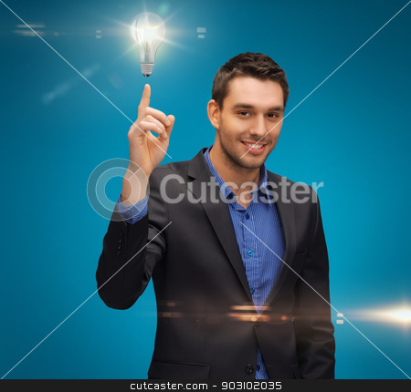 man in suit with light bulb stock photo, picture of man in suit with light bulb by Syda Productions