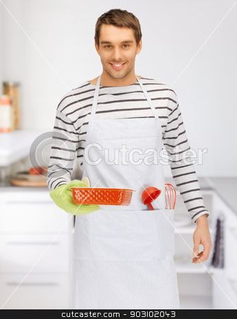 cooking man at kitchen stock photo, bright picture of cooking man at kitchen by Syda Productions