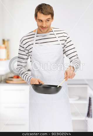 handsome man with pan at kitchen stock photo, bright picture of handsome man with pan at kitchen by Syda Productions