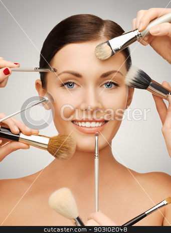beautiful woman with brushes stock photo, bright closeup portrait picture of beautiful woman with brushes by Syda Productions