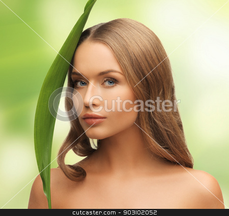 woman with green leaf stock photo, picture of woman with green leaf over white by Syda Productions