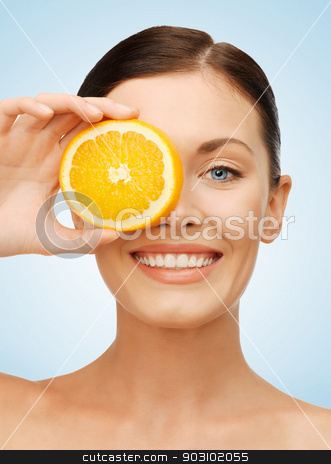 woman with orange slice stock photo, bright picture of beautiful woman with orange slice by Syda Productions