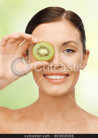 woman with kiwi slice stock photo, bright picture of beautiful woman with kiwi slice by Syda Productions