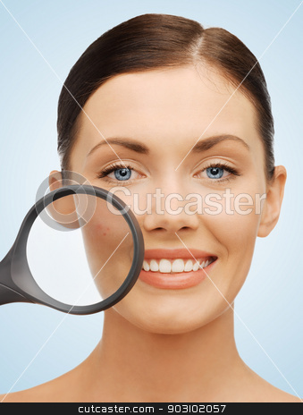 woman with magnifying glass over acne stock photo, bright picture of beautiful woman with magnifying glass over acne by Syda Productions