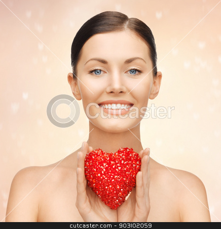 woman with heart stock photo, bright picture of beautiful woman with heart by Syda Productions