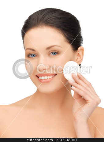 beautiful woman with cotton pad stock photo, bright picture of beautiful woman with cotton pad by Syda Productions