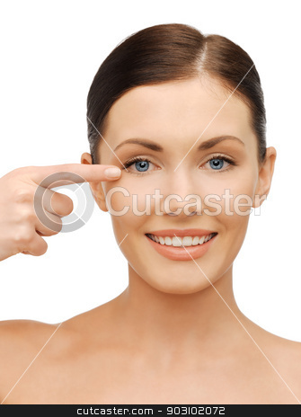beautiful woman pointing to eye stock photo, picture of beautiful woman pointing to eye by Syda Productions