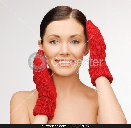 woman in mittens stock photo, bright picture of beautiful woman in red mittens.. by Syda Productions