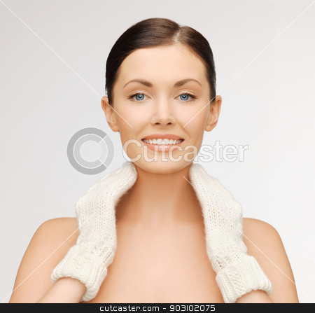 woman in mittens stock photo, bright picture of beautiful woman in white mittens.. by Syda Productions