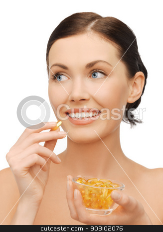 woman with vitamins stock photo, bright picture of beautiful woman with vitamins by Syda Productions
