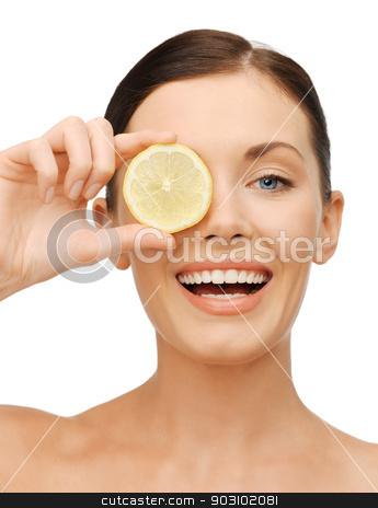 woman with lemon slice stock photo, bright picture of beautiful woman with lemon slice by Syda Productions