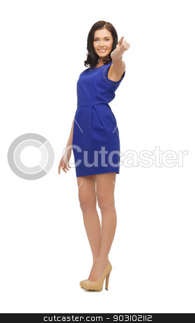 woman in blue dress pointing her finger stock photo, lovely woman in blue dress pointing her finger by Syda Productions