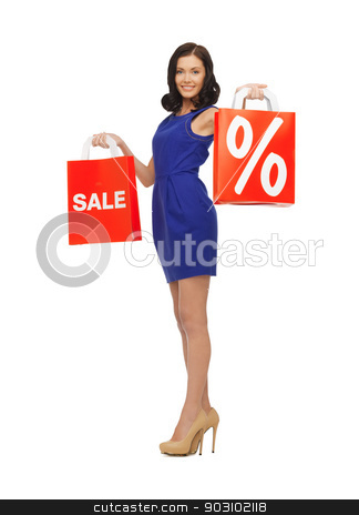 beautiful woman in blue dress with shopping bag stock photo, picture of beautiful woman in blue dress with shopping bag by Syda Productions