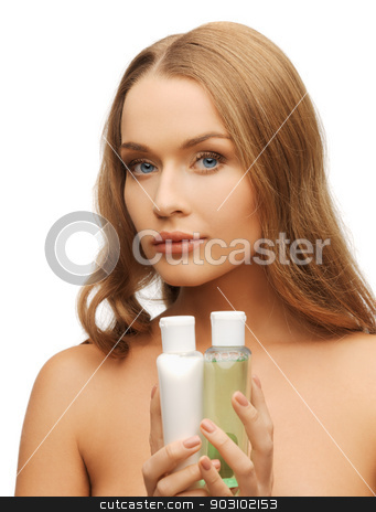 woman with cosmetic bottles stock photo, bright picture of woman with cosmetic bottles by Syda Productions