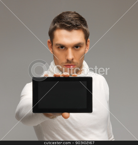man with tablet pc stock photo, bright picture of futuristic man with tablet pc by Syda Productions