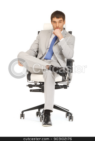 man sitting in chair stock photo, bright picture of handsome man sitting in chair by Syda Productions