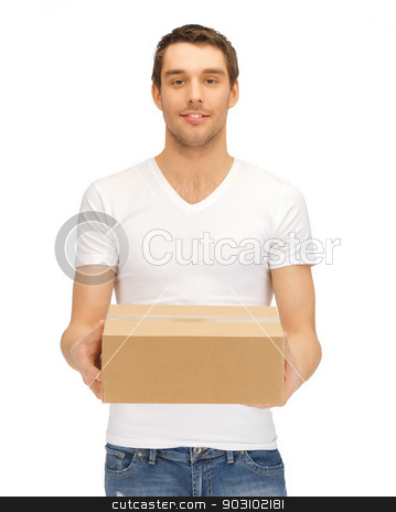 handsome man with big box stock photo, picture of handsome man with big box. by Syda Productions