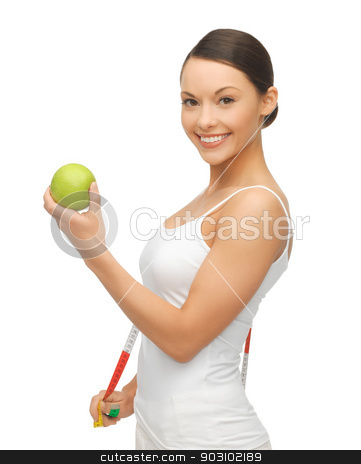 woman with measuring tape and apple stock photo, picture of woman with measuring tape and apple by Syda Productions