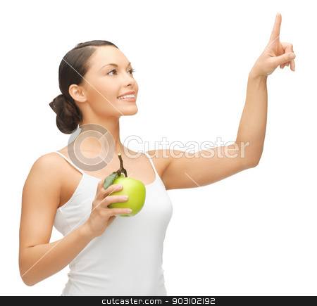 woman with green apple stock photo, woman holding apple and working with something imaginary by Syda Productions