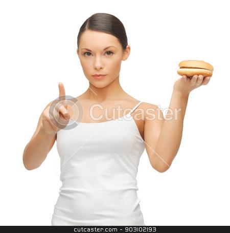 woman with hamburger stock photo, bright picture of beautiful woman with hamburger by Syda Productions