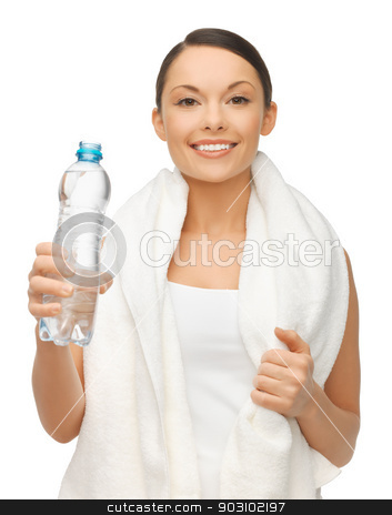 woman with towel and bottle of water stock photo, picture of woman with bottle of water and towel by Syda Productions