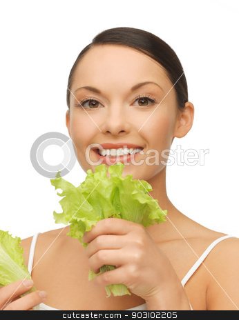 woman with lettuce stock photo, bright picture of beautiful woman with lettuce by Syda Productions