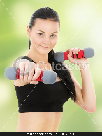 fitness instructor stock photo, lovely fitness instructor with dumbbells by Syda Productions