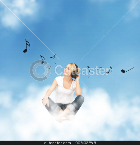 happy teenage girl in big headphones stock photo, picture of happy teenage girl in big headphones sitting on cloud by Syda Productions