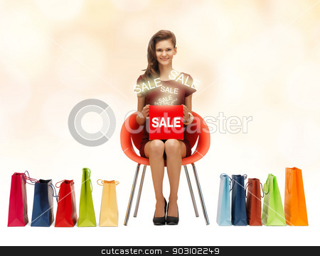 girl in red dress with shoes, bag and sale sign stock photo, picture of teenage girl in red dress with shoes, bag and sale sign by Syda Productions